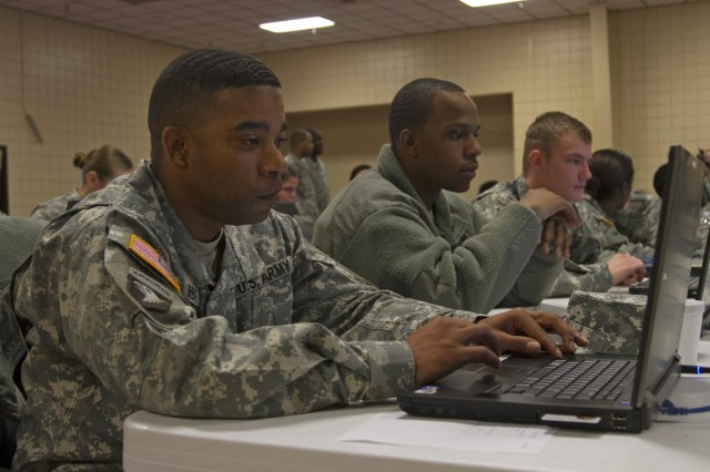 Along with other human resources soldiers, Staff Sgt. Albert Wheat, assigned to 90th Human Resources Company stationed at Fort Stewart, Ga., works on a personnel management system practical exercise on a desktop computer during an HR Company training class at Silver Scimitar 2013 in Fort Devens, Mass., March 11. Wheat, originally from San Antonio, trained with other human-resources professionals from around the world in preparation for his unit's upcoming deployment later this year. Silver Scimitar is an annual two-week training event dedicated to providing human-resources service members with predeployment training similar to what combat-arms personnel receive at the National Training Center or Joint Readiness Training Center. (U.S. Army photo by: Sgt. Terence Ewings, 24th Press Camp Headquarters)
