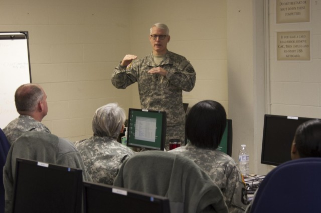 Maj. Gen. Peter Lennon, commanding general of the 377th Theater Sustainment Command, speaks to human resources soldiers taking part in a senior-leaders class during Silver Scimitar 2013 in Fort Devens, Mass., March 12. Silver Scimitar is an annual two-week training event dedicated to providing human-resources service members with predeployment training similar to what combat-arms personnel receive at the National Training Center or Joint Readiness Training Center. Lennon visited the Silver Scimitar to observe the event and his troopers who were participating in the training. (U.S. Army photo by: Sgt. Terence Ewings, 24th Press Camp Headquarters)