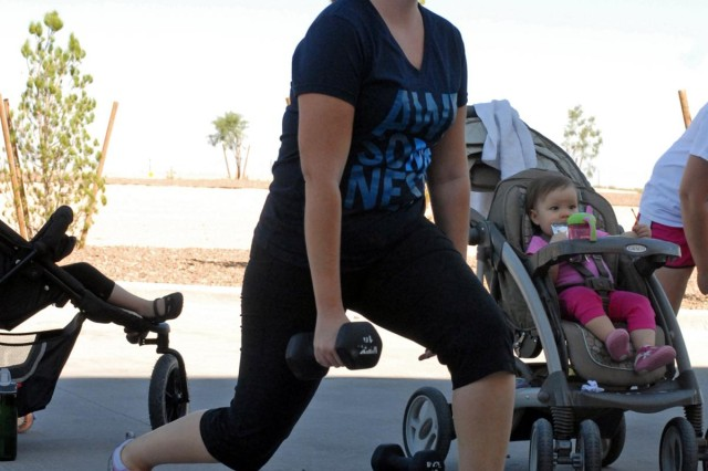 Angela Vanputte, a military spouse of Fort Bliss and native of Chicago, Ill., performs lunges while carrying dumbbells during a Stroller off Stress class at the Soto Physical Fitness Facility on East Fort Bliss, Sept. 17. The Morale, Welfare and Recreation sponsored class is designed to help participants stay in shape and build their own personal fitness regiment. (U.S. Army photo by: Sgt. Terence Ewings, 24th Press Camp Headquarters.)
