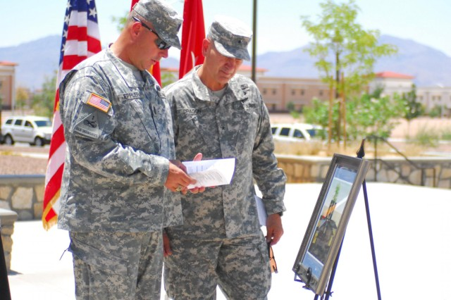 Command Sgt. Maj. Thomas Eppler, command sergeant major for the 4th Brigade Combat Team, 1st Armored Division, and Brig. Gen. Randal Dragon, commanding general of Brigade Modernization Command, take a look at an image of the future 3rd Brigade Combat Team, 1st Armored Division, Bulldog Brigade Memorial after the memorial's groundbreaking ceremony June 25. Leaders from Fort Bliss and visitors from the El Paso, Texas, community gathered to recognize the future site of the memorial which honors the fallen soldiers who gave their lives during Operation Iraqi Freedom and Operation Enduring Freedom. U.S. Army photo by: Sgt. Terence Ewings, 24th Press Camp Headquarters.