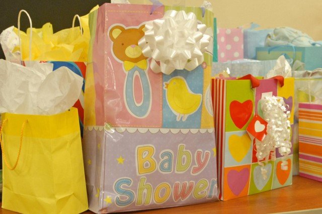 Gift bags containing baby goods such as diapers, pacifiers, baby wipes and bottles, fill the donation table at the community baby shower hosted by the Fort Bliss Army Volunteer Corps at the Army Community Service Center, Sept. 6. The baby shower, which was a baby-items drive, was designed to help stock the shelves of the installation's Junior Enlisted Family Center and other El Paso community nonprofit agencies.