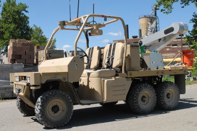 The advanced ground sample collection platform, which is remotely controlled, is driven down a road at the Muscatatuck Urban Training Center, Ind., Aug. 6. The robotic system, developed by the Defense Threat Reduction Agency, is designed to allow operational forces to perform radiation reconnaissance and ground sampling missions after a nuclear detonation. The robotic system can be controlled manually or remotely. This reduces the need to send Soldiers into a contaminated area.