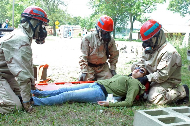 Troopers from the 178th Engineer Company out of Fort Polk, La., treat a 'survivor' of a simulated nuclear-blast area during the Vibrant Response 13 field training exercise at the Muscatatuck Urban Training Center, Ind., July 26. The rescue technicians were responsible for treating and evacuating role-players, acting as survivors, during the man-made disaster-training venue.