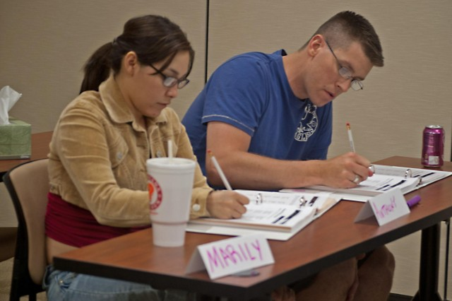 Spc. Anthony D. Tindell, a combat medic assigned to the Combat Aviation Brigade, 1st Armored Division, and his wife Marily Tindell take notes during a Fort Bliss Army Family Team Building class, April 14. Tindell, a native of San Diego, Calif., and his wife who is originally from San Antonio, Texas, wanted to attend the class together to gain organization, communication and time management skills that are taught in the AFTB program.