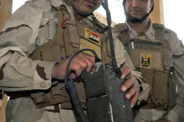 Pfc. Naiem Gelewa, a signal support systems soldier from 1st Battalion, 9th Brigade, 3rd Iraqi Army Division, trains on a combat network radio system during a basic communications class at the Ghuzlani Warrior Training Center, April 6. Gelewa, a native of Nasiriyah, Iraq, trains with advisors from 1st Squadron, 9th Cavalry Regiment, 4th Advise and Assist Brigade, 1st Cavalry Division, at the training center on COS Marez to become proficient in operating communication support systems on the battlefield.