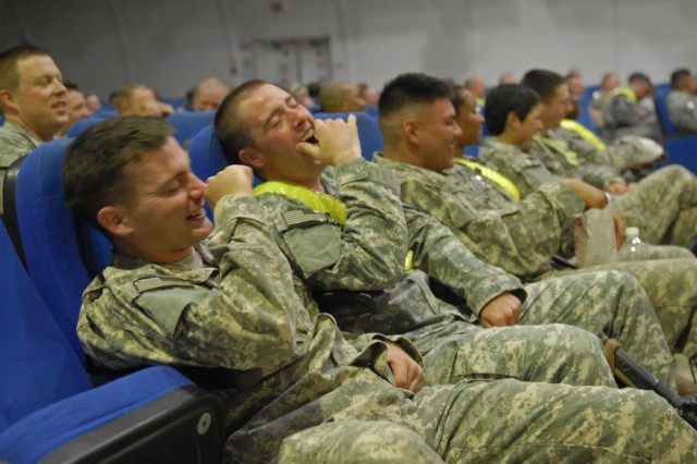 Soldiers from the 4th Advise and Assist Brigade, 1st Cavalry Division, share a laugh during comedic performances from the Comics Ready to Entertain tour that visited the troops Nov. 5.