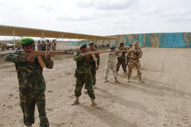 Soldiers assigned to the 26th Romanian Infantry Battalion teach troops from the 3rd Battalion, 39th Iraqi Army Brigade the proper firing techniques to use in a combat situation during the first phase of their commando training, which was completed on Camp Ur near Contingency Operating Base Adder, Iraq, April 26.