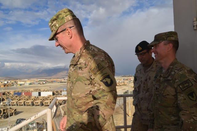 Maj. Gen. James C. McConville, commanding general Regional Command East and Combined Joint Task Force 101, looks down on retrograde vehicles staged for transportation at the AFSBn-Bagram Logistics Task Force BAF during his visit to 401st Army Field Support Brigade Mar. 14.