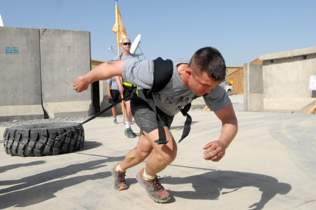 U.S. Army 1st Lt. Nick Gough of Headquarters and Headquarters Company, 702nd Brigade Support Battalion, 4th Brigade Combat Team, 2nd Infantry Division, strains to beat the clock on the return trip during the tire pull event at the battalion's mid-tour celebration March 17, 2013, at Kandahar Airfield, Kandahar province, Afghanistan. (U.S. Army photo by Staff Sgt. Scott Tynes/Released)