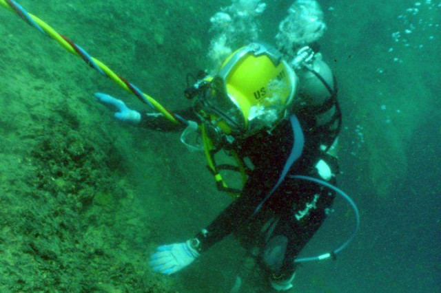 First Lt. Christie Plackis, the fourth female diver in the history of the Army, who serves as the executive officer for the 74th Engineer Dive Detachment, currently deployed from Joint Base Langley-Eustis, Va., climbs out of a hole in Vortex Springs during dive school at the Naval Diving and Salvage Training Center in Panama City, Fla., while training for restricted diving conditions.