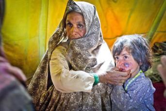 Village locals gather for a Medical Civic Action Program (MEDCAP), March 14, in Kandahar province, Afghanistan. (U.S. Army photo by 2nd Lt. Jennifer Frazer, 102nd Mobile Public Affairs Detachment)