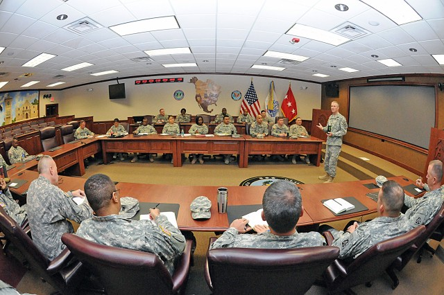 Command Sgt. Maj. Hu Rhodes, U.S. Army North (Fifth Army) and senior enlisted leader for Fort Sam Houston and Camp Bullis, Texas, speaks with the command's senior noncommissioned officers about the importance of being directly involved in the professional development of their Soldiers. Rhodes met with his enlisted leaders at the main conference room in the Army North historic Quadrangle.