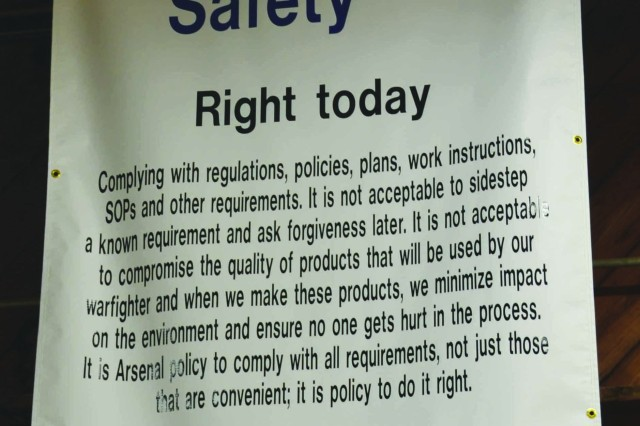 A good example of the Quality, Environmental and Safety Management System policy hangs from the ceiling in the Directorate of Public Works Carpenter Shop