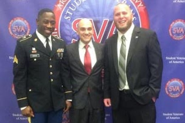 Larry Huff (right) of VetOut, and his student Sgt. Kwame Drew (Left)  pose for a photo with Mike Dakduk, Student Veterans of America's executive director.
