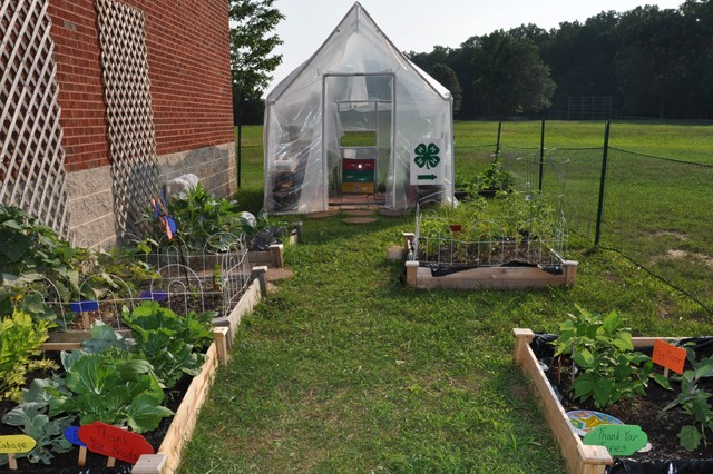 The completed 4H site outside the APG South youth center includes a greenhouse build project and community garden.