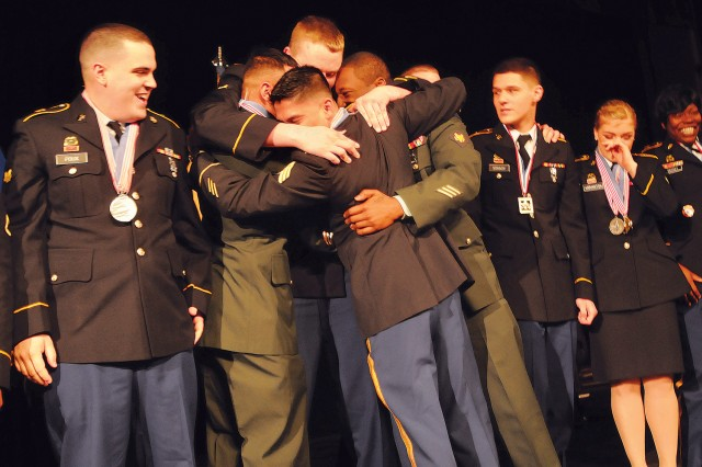 Fort Hood, Texas, team members embrace after accepting the award for best team during the 38th Military Culinary Arts Competitive Training Event Awards Ceremony March 14 at the Lee Theater. The Hood team erased a 28-year drought in winning the coveted title.