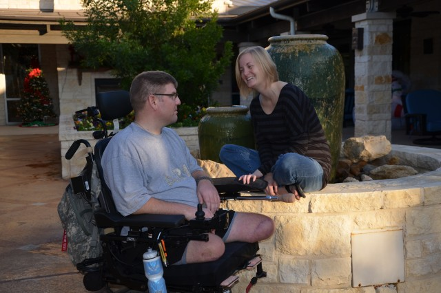 Sgt. Ed Matayka spends a quiet moment with his wife, Karen, at the Warrior and Family Support Center near San Antonio Military Medical Center, Texas. The Vermont National Guard medic lost both legs and suffered a brain injury after a roadside bomb blew up his vehicle in Afghanistan, in July 2010.