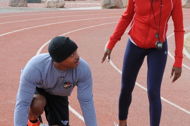 FORT CARSON, Colo. -- Jerrod Fields, left, talks with World Class Athlete Program events coordinator Shanise Lewis during an informal workout session March 16 at McKibben Physical Fitness Center's outdoor running track.