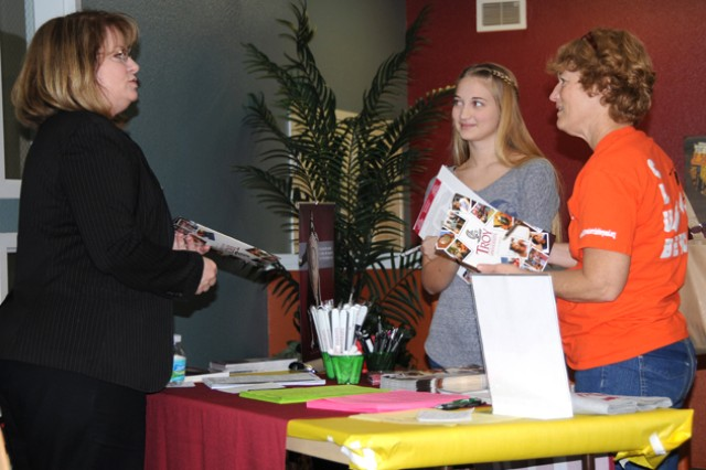 Rachel Stidley, military Family member, and her mother, Janine, speak with Sandy Henry, director of enrollment at Troy University Dothan, during the Youth College and Job Fair March 16 about what the university has to offer.