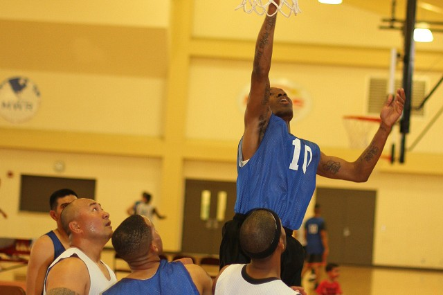 Terry Saunders, 1st Battalion, 14th Field Artillery forward puts back a rebound for an easy two points during an intramural basketball game March 14 at Fort Sill's Rinehart Fitness Center.