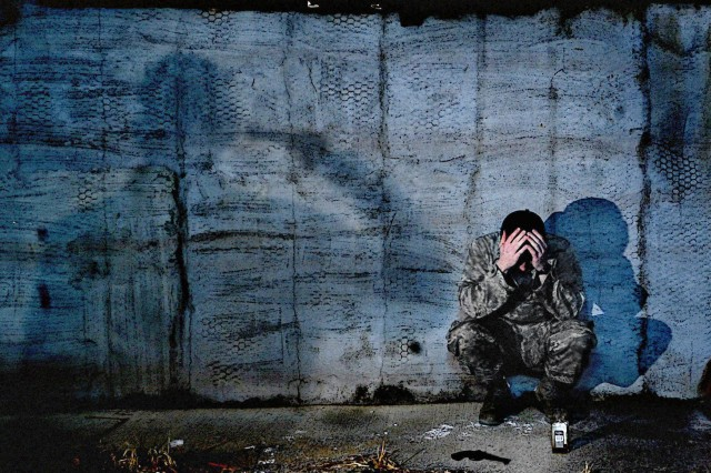 A depressed service member holds his head in this photo illustration. Lt. Gen. Howard B. Bromberg, the Army's deputy chief of staff, G-1, and other DOD leaders testified March 21, 2013, to the House Armed Services, Military Personnel Subcommittee hearing on suicide prevention.