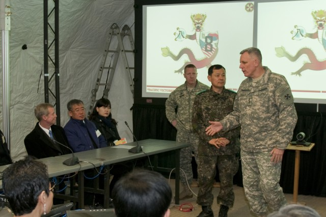 Eighth Army Commanding General Lt. Gen. John D. Johnson (right) hosts community leaders at Warrior Base, South Korea, on the last day of Exercise Key Resolve.