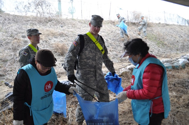 "DONGDUCHEON, South Korea "" Soldiers from the 210th Fires Brigade and 1st Armored Brigade Combat Team, 2nd Infantry Division and the citizens of Dongducheon take part in an annual clean-up exercise sponsored by the city of Dongducheon. Soldiers of the Warrior Division are committed to working together as neighbors to make the community a better place, demonstrating Katchi Kapshida. This event allows U.S. Soldiers and members of the community to work together and learn about each other, while improving the environment. (U.S. Army photos by 210th Fires Brigade Public Affairs Team/Released)."