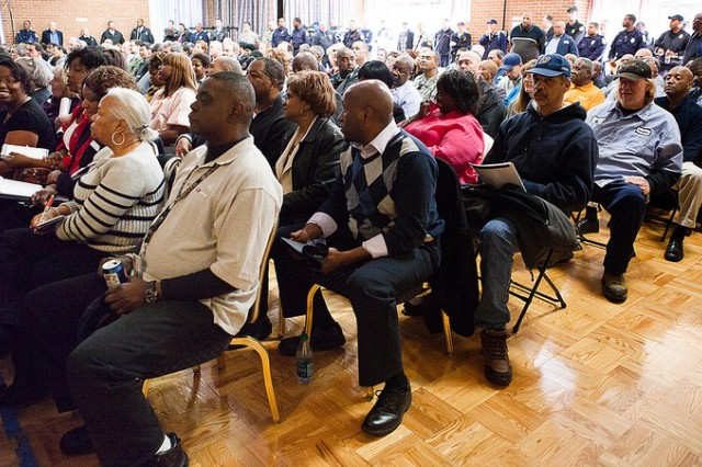 Attendees of the furlough briefing for the JBM-HH workforce watch as Col. Fern O. Sumpter, JBM-HH commander, gives remarks March 19 in the community center.