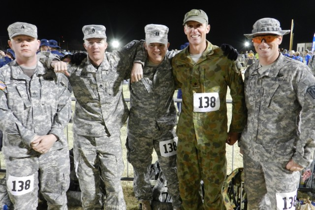 From left, Sgt. Anthony Blagg, Staff Sgt. Kevin Giger, Capt. Aaron Gerlitz, Australian army Maj. James Hepworth and Chief Warrant Officer Christopher Crozier pose for a picture before beginning the Bataan Memorial Death March at White Sands Missile Range, N.M., March 17, 2013. The team finished the 26.2-mile course with 35-pound packs in just over eight hours.