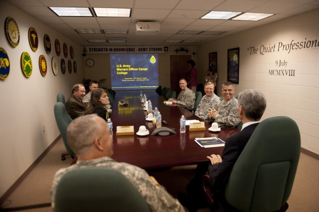 Secretary of the Army John McHugh is briefed by Col. Stanley Smith, Commandant of the U.S. Army Warrant Officer Career College, while at Fort Rucker, Ala. Seated to his left is Maj. Gen. Kevin W. Mangum, Commanding General of the Aviation Center of Excellence and Fort Rucker, March 18, 2013. (U.S. Army photo by Spc. John G. Martinez)