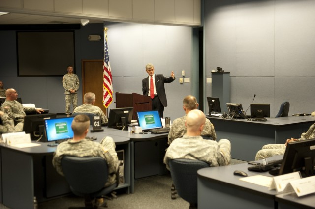Secretary of the Army John McHugh speaks with senior warrant officers at the U.S. Army Warrant Officer Career College while at Fort Rucker, Ala., March 18, 2013. (U.S. Army photo by Spc. John G. Martinez)