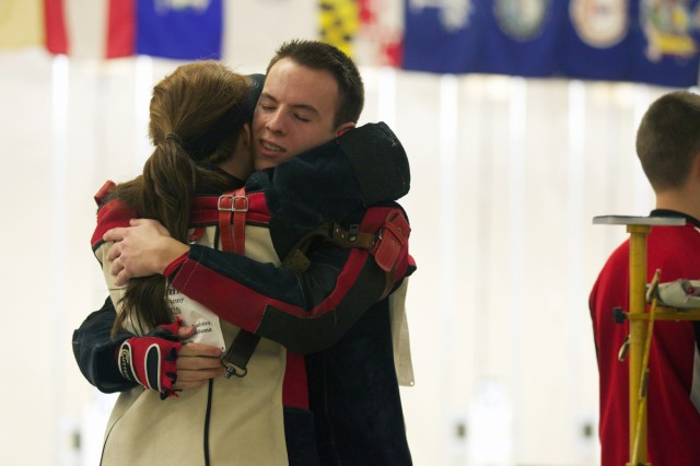 Ozark (Mo.) High School seniors Makennon Doran and Shelby Brummett share a hug before Saturday's precision competition in the JROTC National Air Rifle Championships in Anniston, Ala. Photo by Steve Arel/U.S. Army Cadet Command