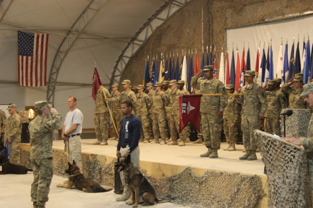 Lt. Col. Heather Serwon, 218th Medical Detachment (Veterinary Service Support) commander, and Kansas native, takes part in a transfer of authority ceremony, held March 16, 2013, on Kandahar Airfield, Afghanistan. The unit provides primary care to more than 700 working dogs located throughout southern Afghanistan, as well run the food safety program for three regional commands.
