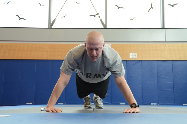Sgt. David Martin, a chaplain's assistant for Grafenwoehr's Headquarters and Headquarters Company, completes two minutes worth of pushups during the Army Physical Fitness Test portion of the Best Warrior Competition at the Grafenwoehr Physical Fitness Center, March 19.