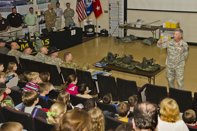 Maj. Gen. Tim Crosby, the program executive officer for Aviation, addresses an assembly of young students during Hampton Cove Elementary School's Career Day on March 15.