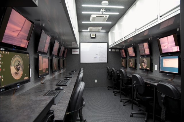 A view from inside the new Mobile Apache Sensors Telemetry Trailer featuring 10 workstations where testers and engineers can see and review test data in real time.