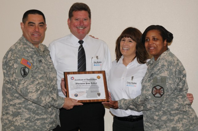 Brig. Gen. Jon D. Lee (left), commander of the 91st Training Division, and Col. Donna Williams (right), Fort Hunter Liggett's Garrison commander, present a certificate of appreciation to Gary Mueller and Cindy Hawkes from Albertsons Paso Robles. The store's customers and community showed their patriotic spirit by purchasing more than 3,000 bags of fresh-baked cookies for the local troops.