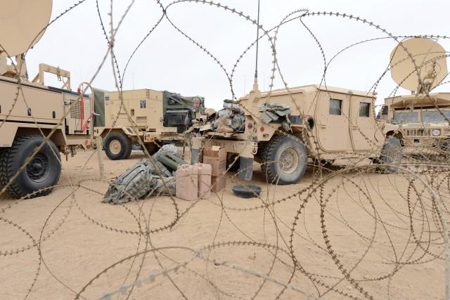 Linguist unloads vehicle at NTC