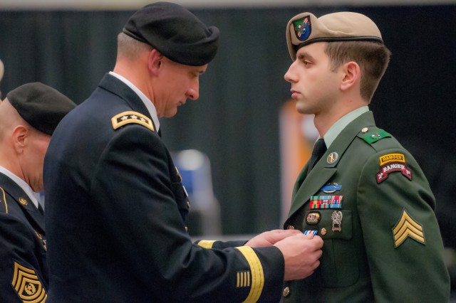 "JOINT BASE LEWIS-McCHORD, Wash.""I Corps commanding general, Lt. Gen. Robert Brown, pins the Silver Star to the uniform of Sgt. Peter Cimpoes, formerly of the 2nd Battalion, 75th Ranger Regiment during a special ceremony at Saint Martin's Marcus Pavilion, Lacey, Wash., Mar. 20. During the ceremony Soldiers of the battalion were also awarded another Silver Star, seven Bronze Star Medals with ""V"" device for Valor, 11 Purple Hearts, four Army Commendation Medals with ""V"" Device for Valor and a Joint Service Commendation Medal with ""V"" device."