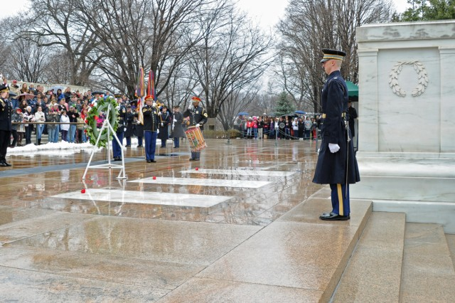 Medal of Honor recipients salute after placing a wreath to honor the fallen at Arlington National Cemetery's (Va.) Tomb of the Unknowns, March 25, 2013. On that date in 1863, the first Medal of Honor was presented to Union Army Pvt. Jacob Parrott.