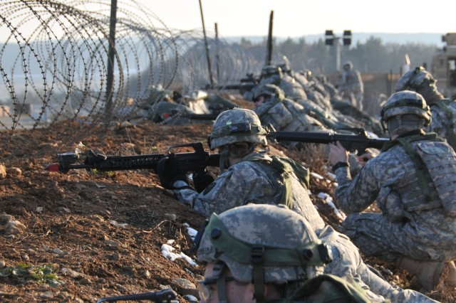 Soldiers with Iron Troop, 3rd Squadron, 2nd Cavalry Regiment, occupy security positions on a surrounding perimeter during a training exercise, March 16, 2013, at Hohenfels, Germany. The Regiment conducted a Mission Readiness Exercise in preparation for an upcoming deployment to Afghanistan.