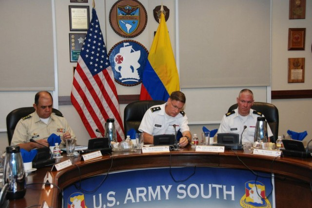 (Left to right) Maj. Gen. Manuel G. Guzman, deputy commander of the Colombian army, Maj. Gen. Frederick S. Rudesheim, U.S. Army South commander, and Command Sgt. Maj. Dennis C. Zavodsky, Army South command sergeant major, take part in army-to-army staff talks at the Army South headquarters at Joint Base San Antonio-Fort Sam Houston, Texas, March 19, 2013.