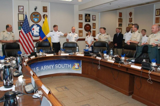 Maj. Gen. Manuel G. Guzman (left), deputy commander of the Colombian army, and Maj. Gen. Frederick S. Rudesheim (2nd from left), U.S. Army South commander, take part in army-to-army staff talks at the Army South headquarters at Joint Base San Antonio-Fort Sam Houston, Texas, March 19, 2013.