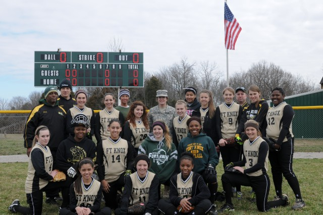 Brig. Gen. Kristin K. French, commanding general of the 3d ESC, poses with the Fort Knox High School softball team before a game March 23 at Fort Knox High School. French was invited to the event to speak to the softball team and to throw the first pitch of the game. (U.S. Army photo by Sgt. Justin A. Silvers)