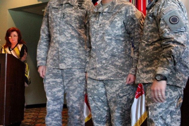 From left to right, U.S. Army Lt. Gen. Robert Brown, I Corps commanding general, Staff Sgt. Catherine Long and Command Sgt. Maj. John Troxell, I Corps senior enlisted adviser, pose for a photo March 22, 2013, during the team courage recognition awards ceremony held at Joint Base Lewis-McChord, Wash. Long, a geospatial intelligence analyst with Headquarters Support Company, 7th Infantry Division, was nominated by her command because of her accomplishments as the only geospatial intelligence analyst in Headquarters Support Company, 7th Infantry Division. (U.S. Army photo by Staff Sgt. Lindsey Kibler/Released)