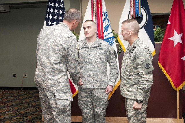 From left to right, Lt. Gen. Robert B. Brown, commanding general of I Corps, presents Sgt. 1st Class Curtis A. James from 1st Battalion, 23rd Infantry Regiment, 3rd Brigade, 2nd Infantry Division, with a commander's coin, March 22,2013, at the Cascade Club, while Command Sgt. Maj. John Troxell, I Corps senior enilsted adviser, looks on, at Joint Base Lewiis McChord, Wash., James was recognized for his service as the 1st Battalion, 23 Infantry Regiment rear detachment First Sergeant during which time he volunteered numerous hours to research and preserve historical artifacts related to three battalions of the 23rd Infantry Regiment, (U.S. Army photo by Staff Sgt. Chris McCullough/Released)