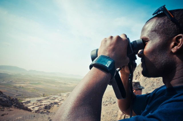 Denver Broncos cornerback Champ Bailey takes in the view from a mountain ridge near Forward Operating Base Masum Ghar, in Kandahar Province, Afghanistan, March 18, 2013. Bailey visited U.S. military bases as part of an NFL-USO morale-building tour.