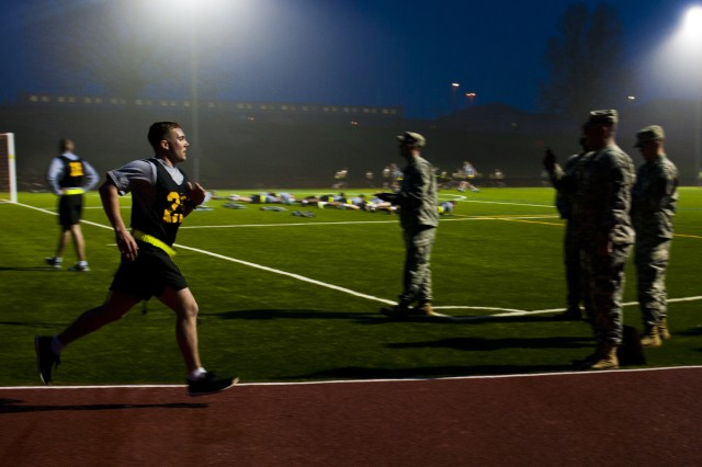 Spc. Joseph Rinck, representing 4th Brigade Combat Team in the 82nd Airborne Division's annual Noncommissioned Officer and Trooper of the Year competition, sprints his final few feet of the two-mile run event of the Army Physical Fitness Test.