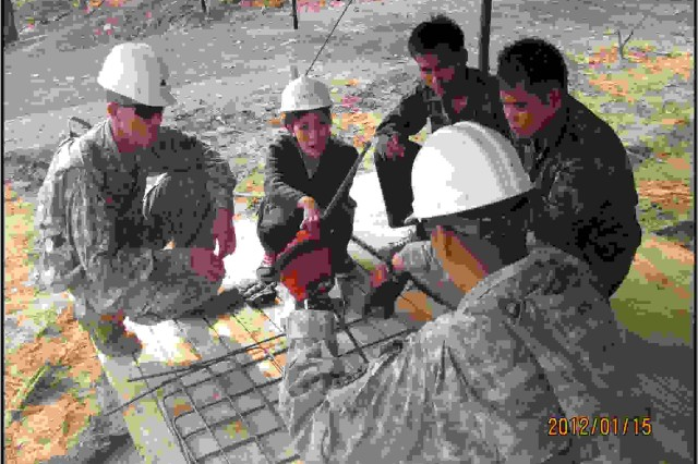 Staff Sgt. Charles Worley, nominee for the Sturgis Award, and a squad leader for 643rd Horizontal Engineer Company, 84th Engineer Battalion, shows his leadership skills by working with locals from Thailand on their engineering project.