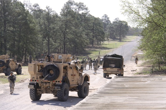 Soldiers of the 4th Brigade Combat Team, 10th Mountain Division, conduct operations during a training exercise at Fort Polk, La., where the unit is the Army's first preparing to deploy with Capability Set 13. The unit worked in an advise-and-assist capacity alongside role players acting as Afghan forces.